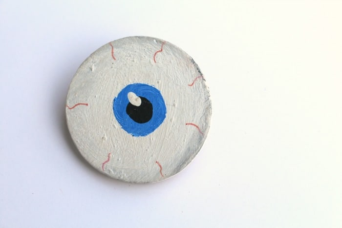 eyeball out of wood circle