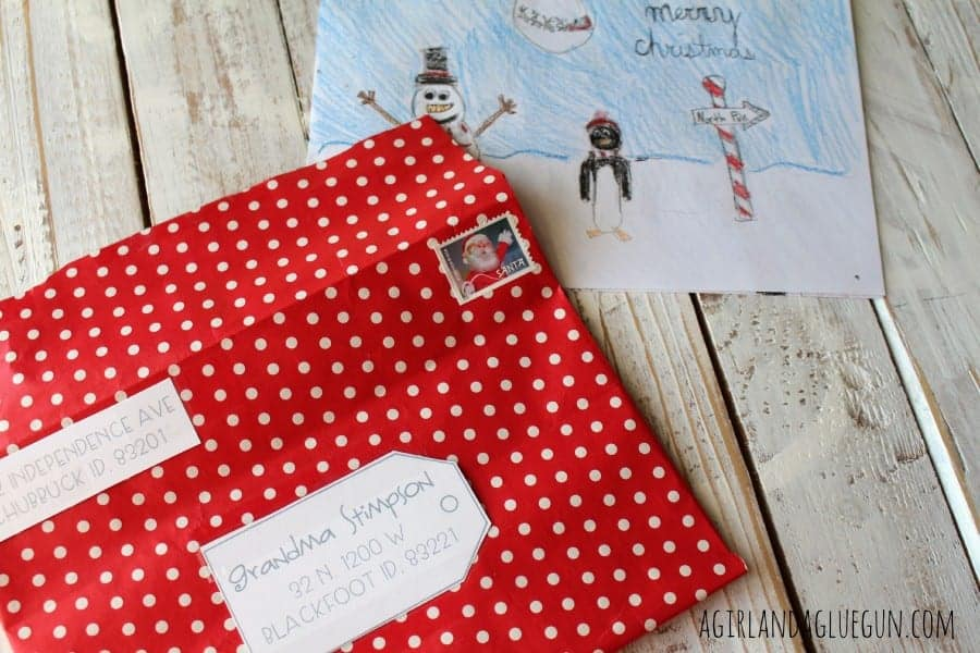 decroated christmas envelopes with wrapping paper