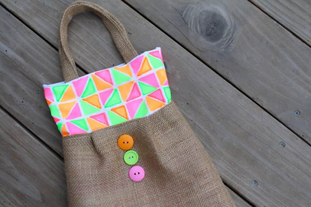 geometric purse with button detail