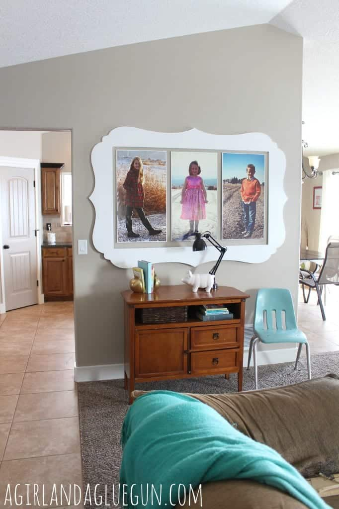 giant wall decorating with pictures and cut it out frames