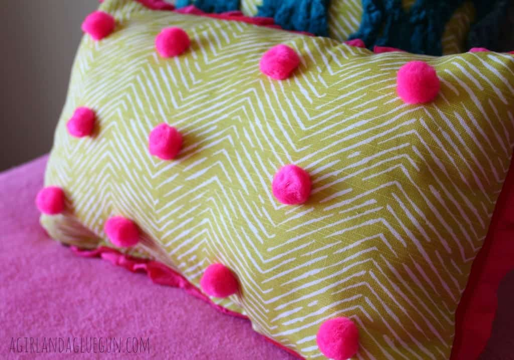 polka dot pillow with poms