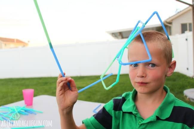 straw building--a girl and a glue gun