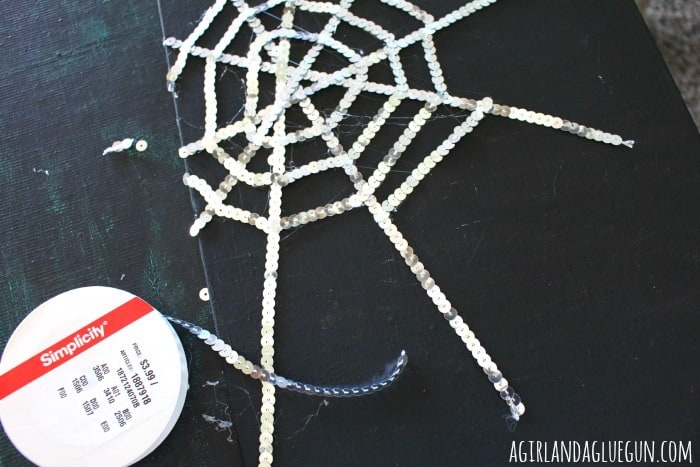 hot glue sequin spider web
