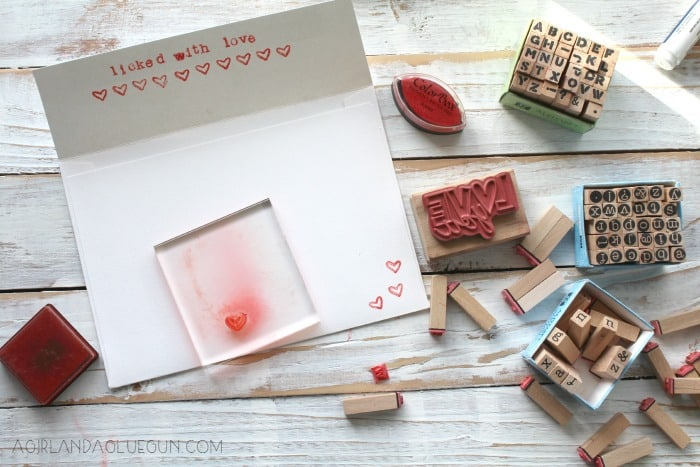 using stamps to decorate a valentines envelope