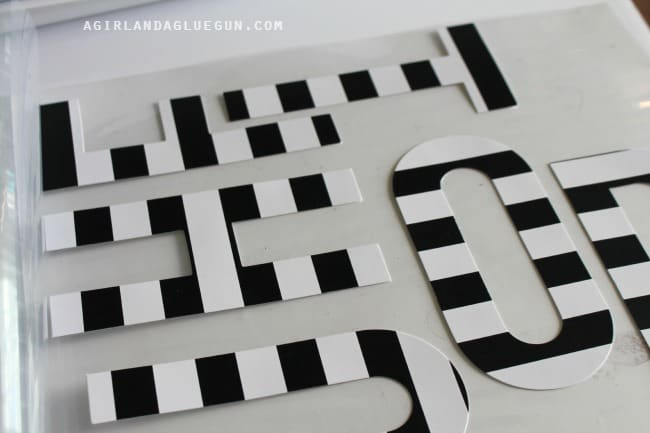 lay out letters on plastic sheet for minc