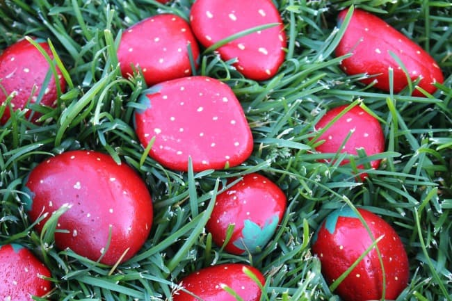 painted rocks to look like strawberries