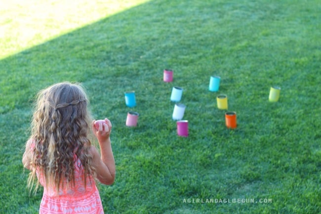 tin can toss with rocks and spray painted cans