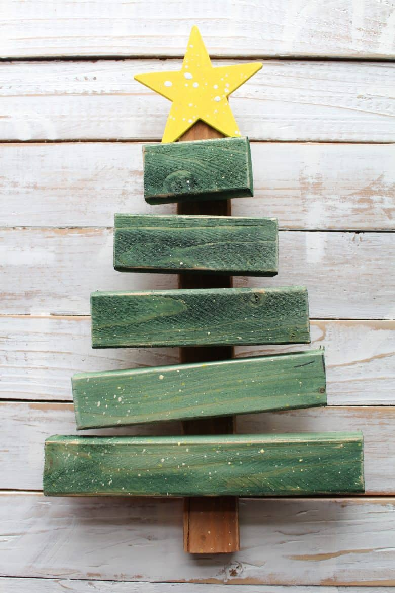 Christmas tree from scrap wood a girl and glue gun