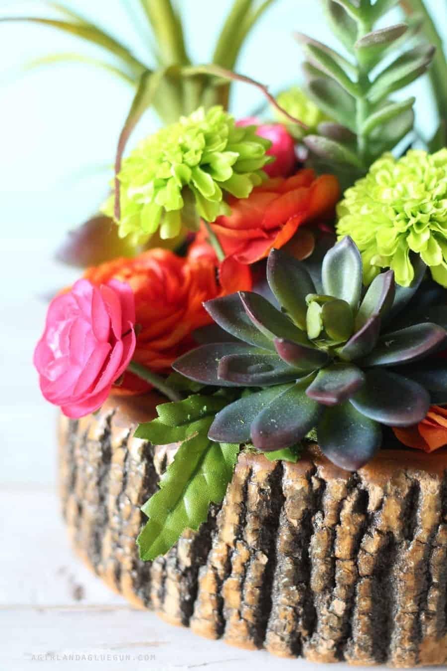 fun close up of wood planter and florals