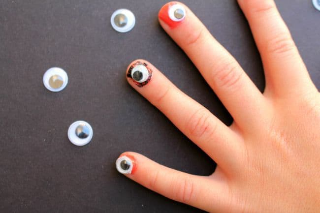 eyeball fingernails a girl and a glue gun