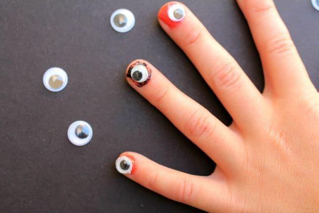 eyeball fingernails a girl and a glue gun