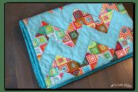 http://www.agirlandagluegun.com/wp-content/uploads/2015/10/colorful-easy-zig-zag-quilt-diy-200x133.png