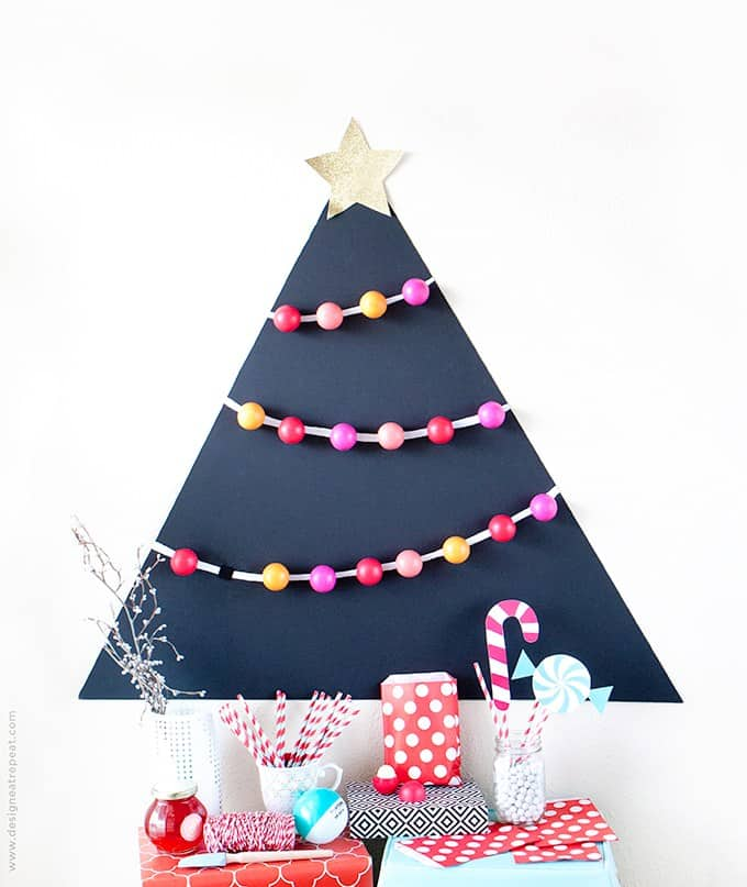 Attach-EOS-lip-balm-to-a-black-matteboard-for-a-fun-holiday-party-favor-idea-Allow-each-guest-to-pick-one-off-the-tree-to-take-home1