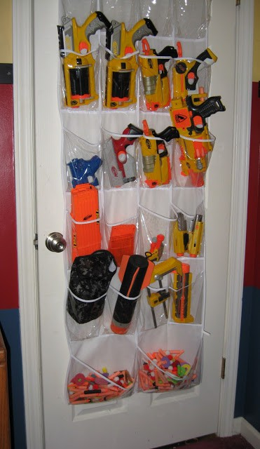 My husband hangs his Nerf Guns armory style in our bedroom.