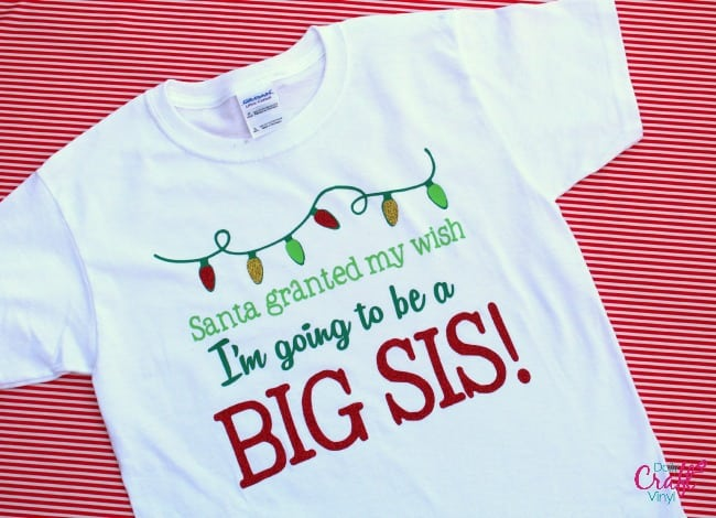 Christmas shirt with heat transfer announcing a new baby