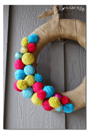 yarn-ball-pom-pom-wreath-tutorial-300x450
