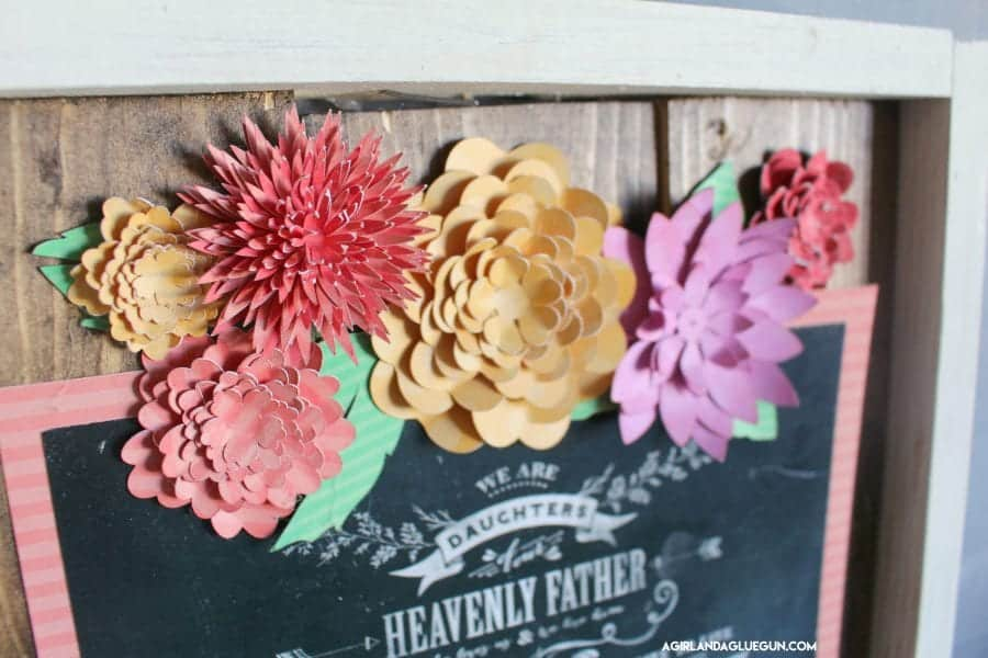flowers on a fun wood sign